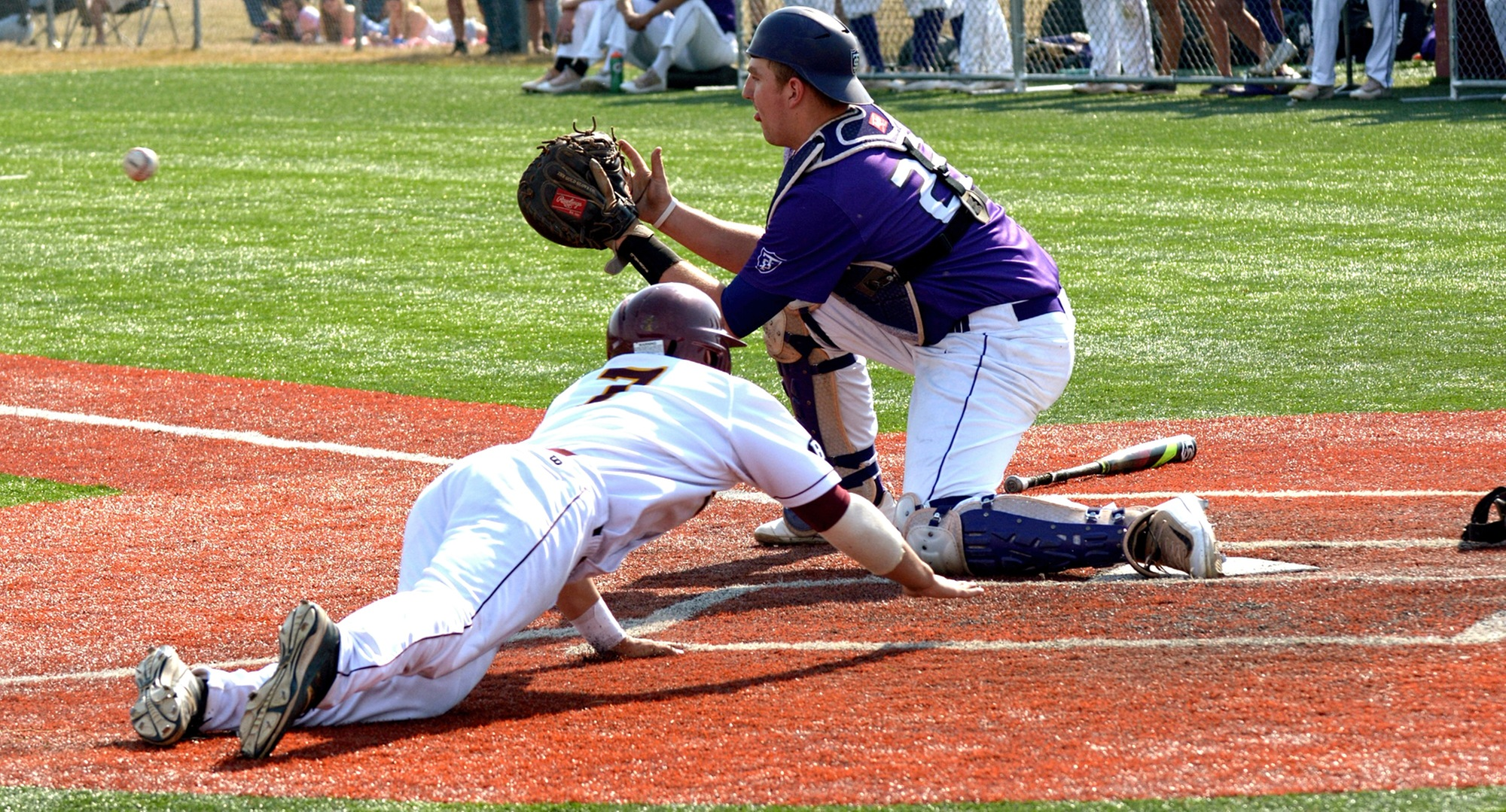 Sophomore Alec Sames slides safely into hom in the second game of the Cobbers' DH with St. Thomas. Hoeft was 3-for-3 in the game.