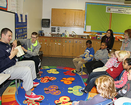 Bison men's basketball volunteers time to read to KDES children