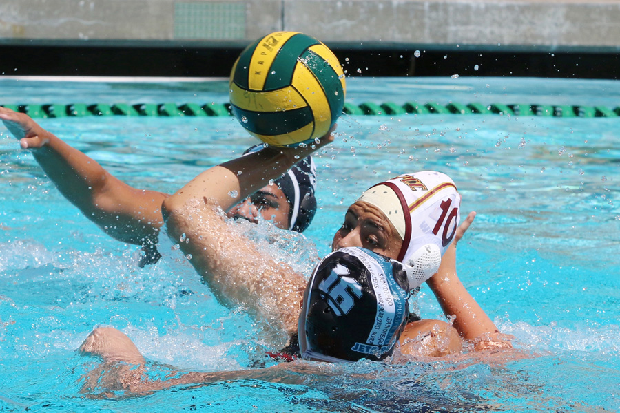 Yesenia Marin was 8-for-her-first-8 shots for goals in the PCC women's water polo team's first two games this season. She goes up for a shot here at the LA Valley Tournament on Saturday, photo by Richard Quinton.