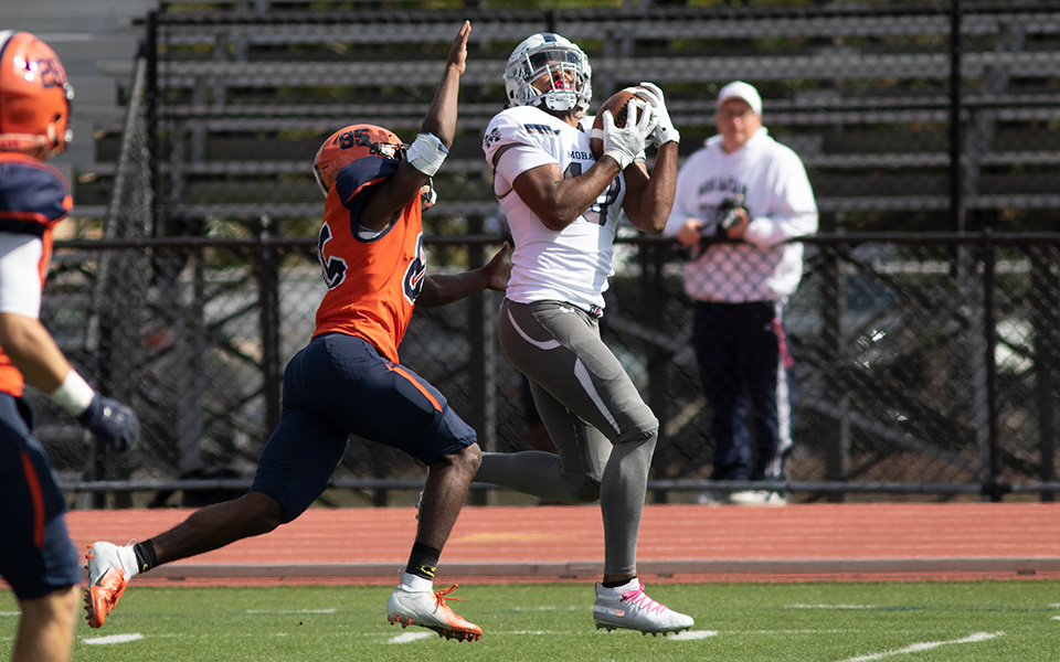 Senior wide receiver Alex Pierce pulls in a 36-yard reception to set up a touchdown just before halftime at Gettysburg College. Photo by Andy Grosh