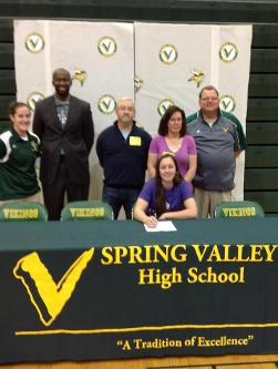 Local Standout signs with Koalas Softball