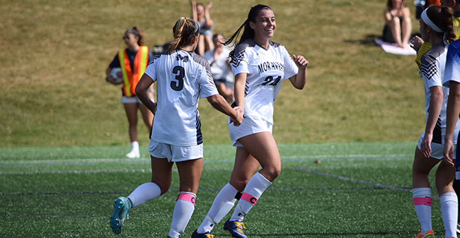 Kristen Parry '20 celebrates her first goal versus Goucher College.