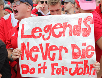 "St. John's fan holds sign saying ""Legends Never Die Do it For John."" (Photo by Wade Gardner, d3photpgraphy.com)"