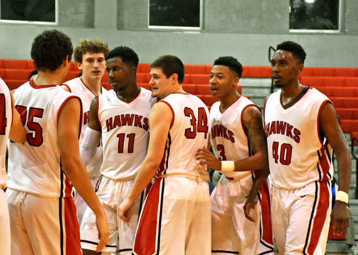 Andre Ashley (#11) is congratulated after making the go-ahead basket in Tuesday's 62-61 win over Belhaven.