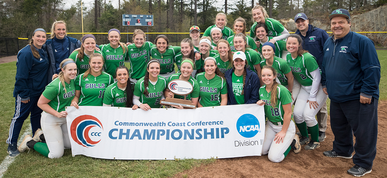 The 2019 Endicott softball team and coaches with the CCC Championship trophy and banner.