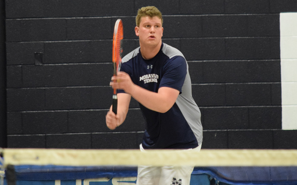 Junior Christopher Csencsits gets ready to serve in doubles action versus Gwynedd Mercy University in Timothy Breidegam Fieldhouse.
