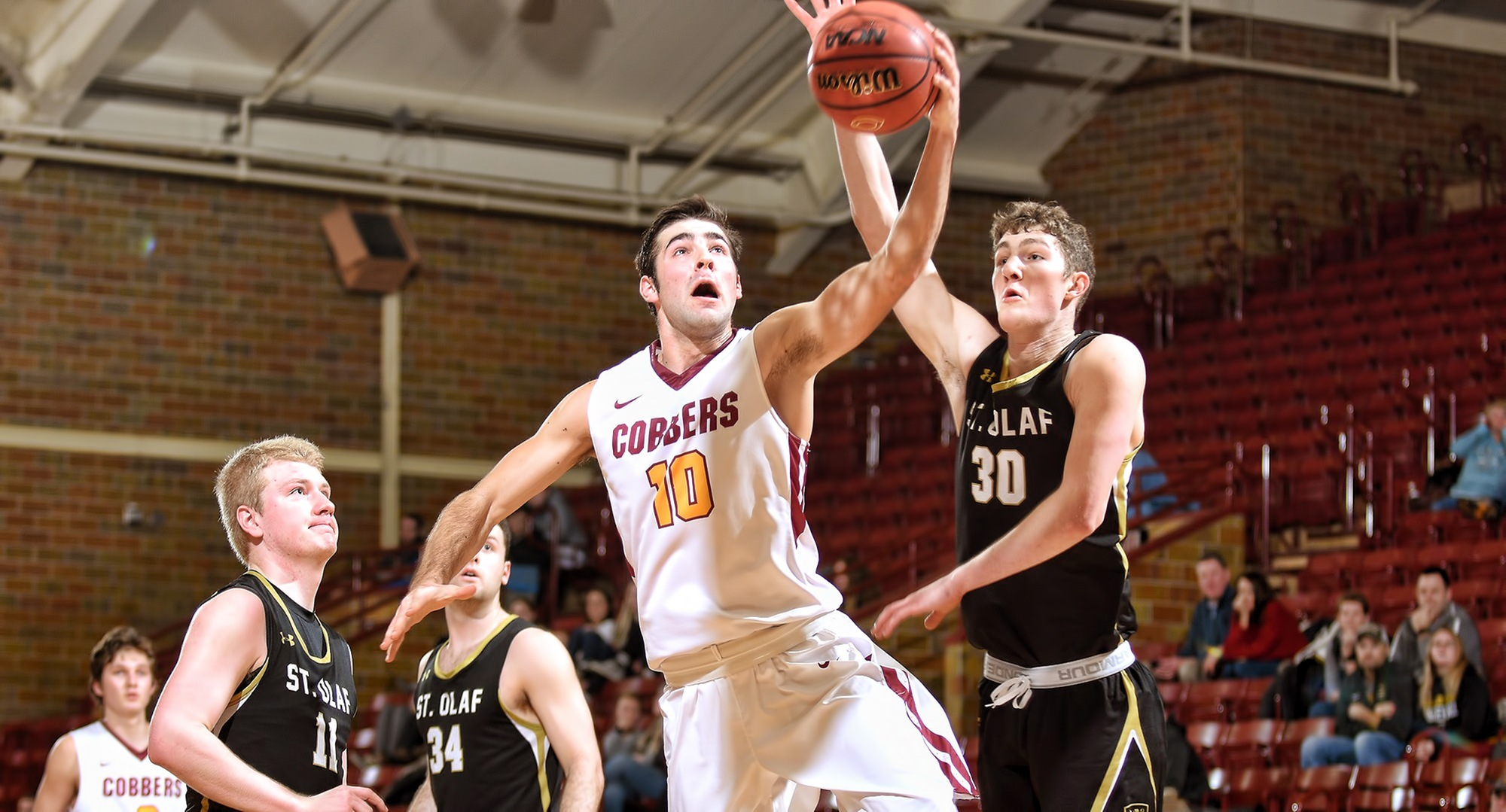 Senior Tommy Schyma goes to the basket in the second half for two of his game-high 18 points against St. Olaf.