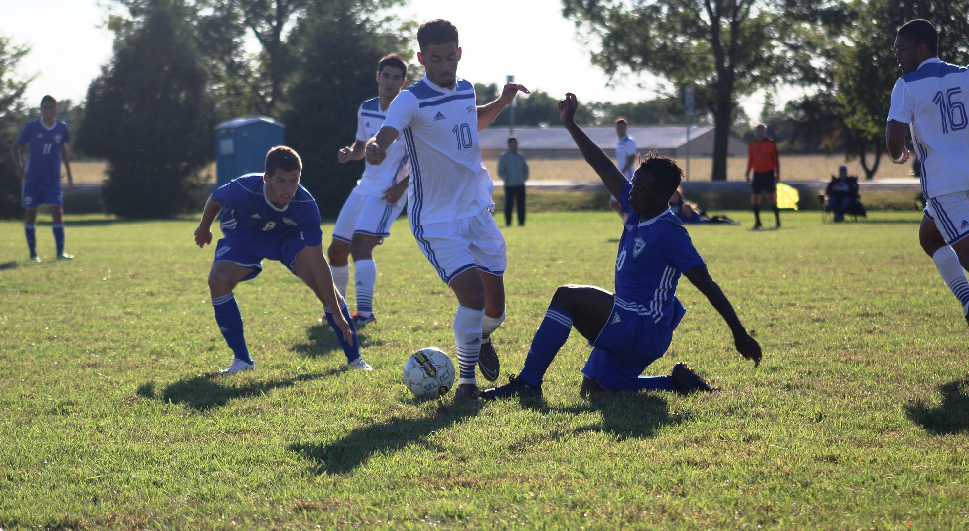 NIACC's Alex Scarano controls the ball in between two Iowa Western defenders in Saturday's ICCAC match.