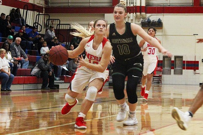 Mesa's Leah Goodman looks to score against the Scottsdale Artichokes in Wednesday night.  Goodman finished with 14 points and five assists on the night. (Photo by Aaron Webster)