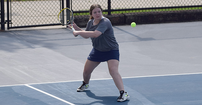 Kristen Cassidy '21 returns a ball in doubles action versus Delaware Valley University.