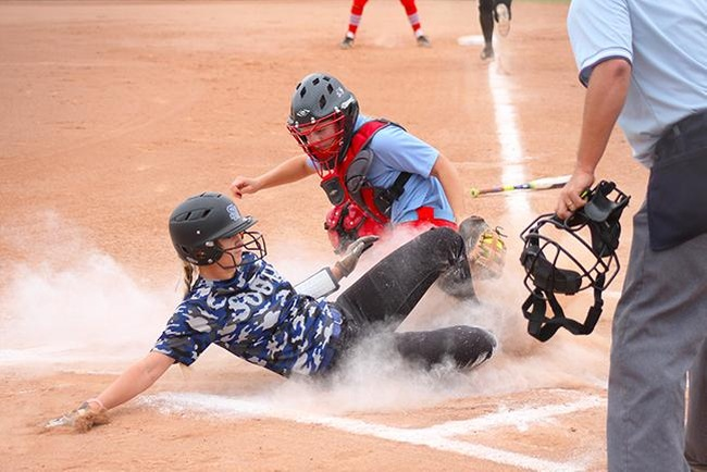Mesa's catcher, Tori Gonzalez, tags out a would be South Mountain run Saturday afternoon. (photo by Aaron Webster)