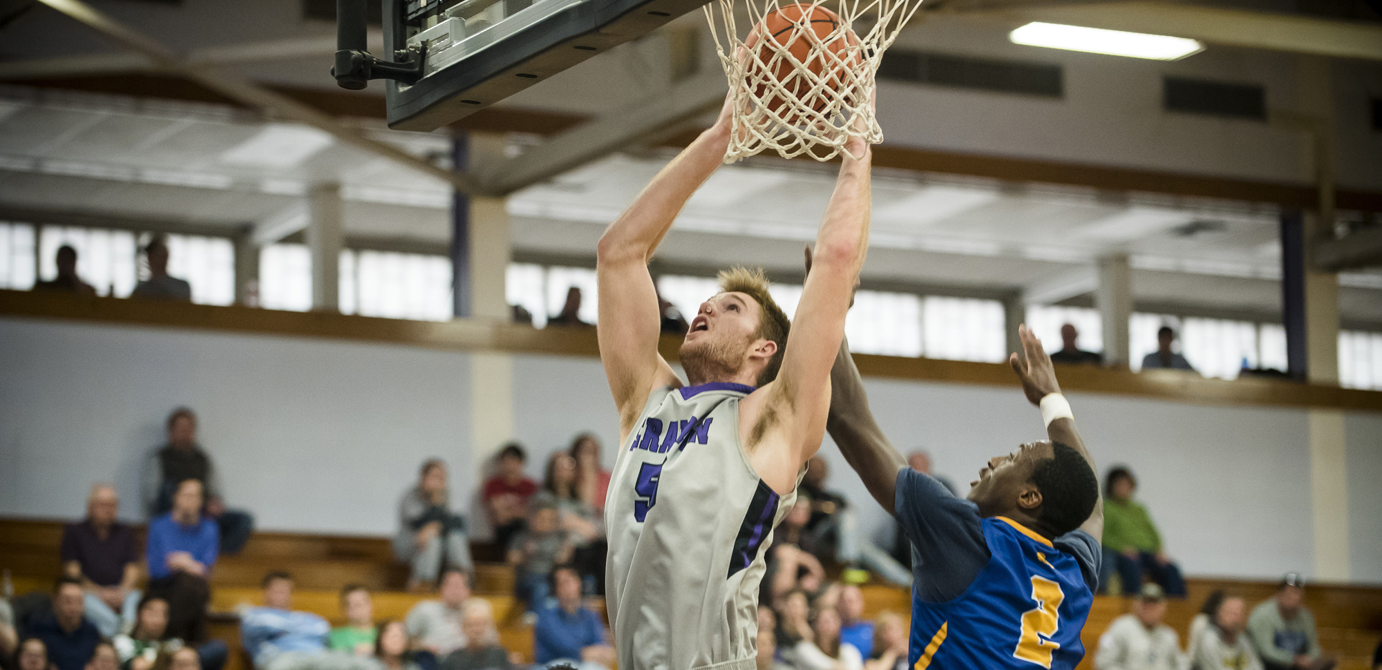 Senior center John Vitkus had 26 points as the Royals beat Oswego State, 82-77, in overtime in the first round of the NCAA Tournament on Friday night.