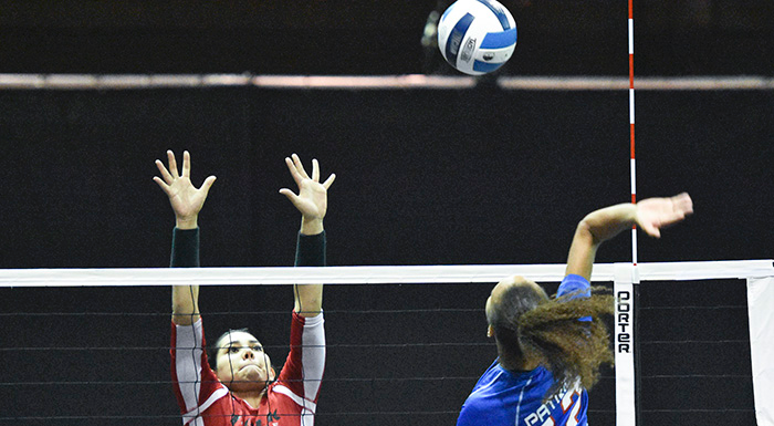 Kathya Garcia goes for a block against Central Florida. (Photo by Tom Hagerty, Polk State.)