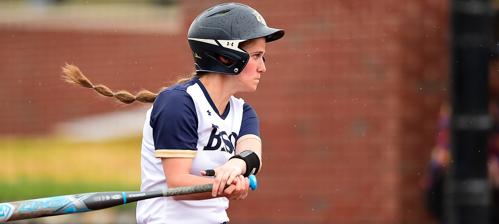 Gallaudet softball Kendall Hudson singles during a day game