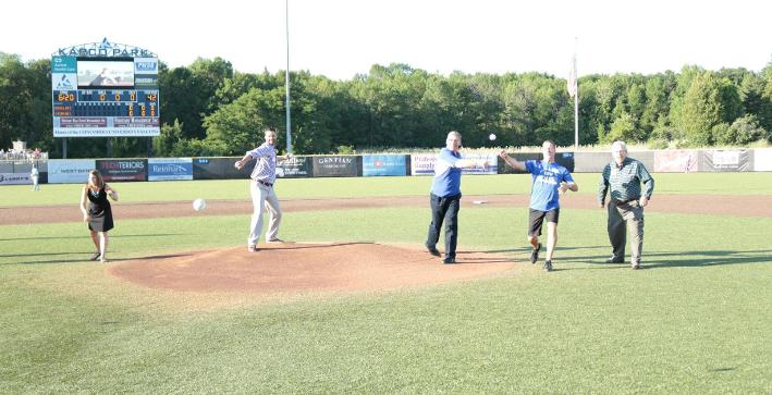 2016 inductees throwing out first pitch at Lakeshore Chinooks game