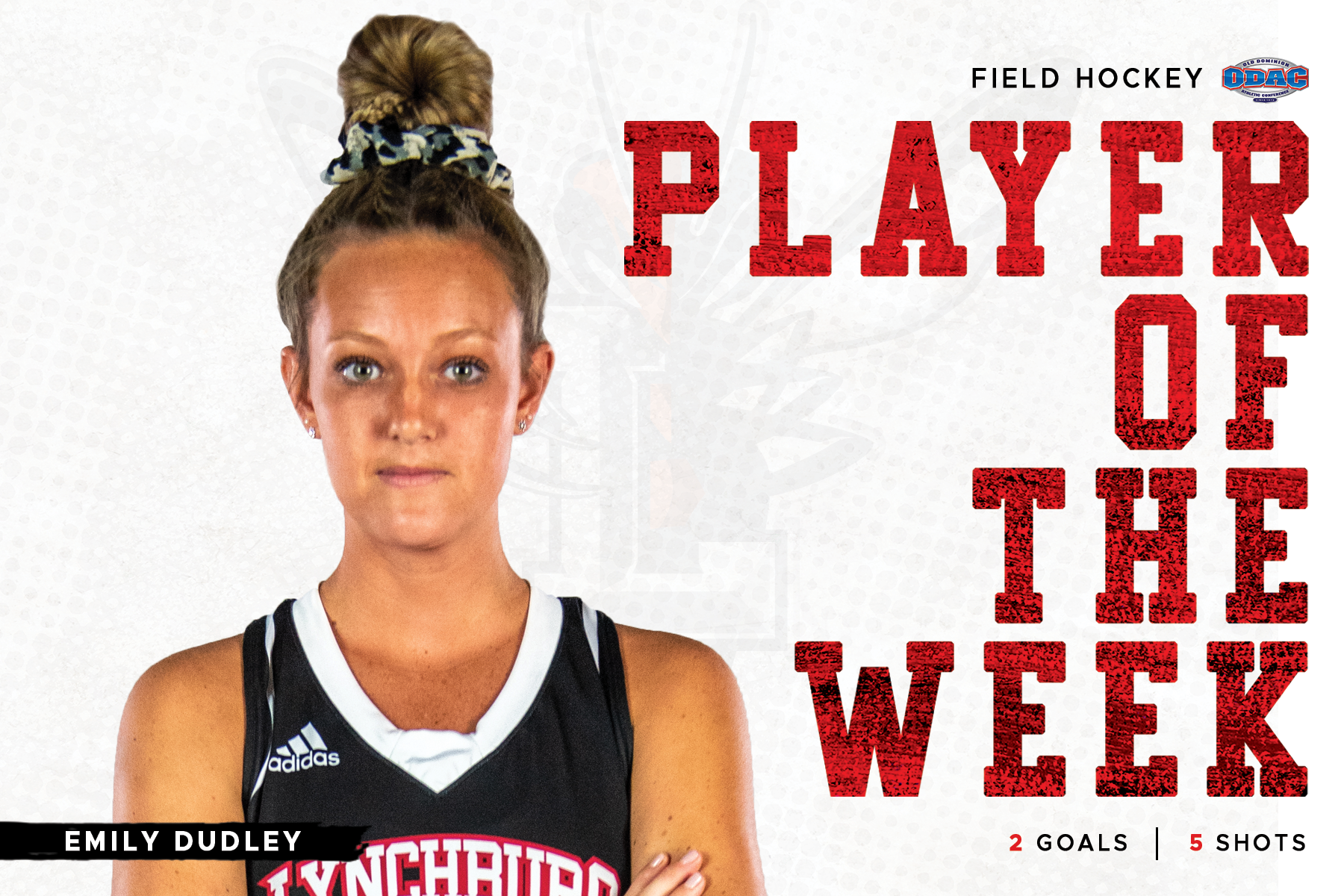 Emily Dudley in black uniform standing arms crossed. Image cut out on top of white background with red text: Player of the week.