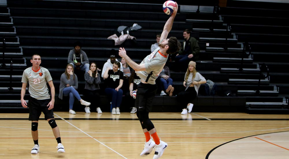 Men's volleyball splits home opening night matches