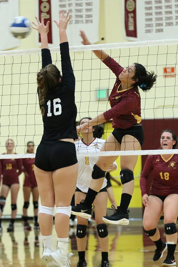 Leslie Rivera pounds a kill during PCC's season-opening win at Saddleback College Wednesday evening, photo by Richard Quinton.