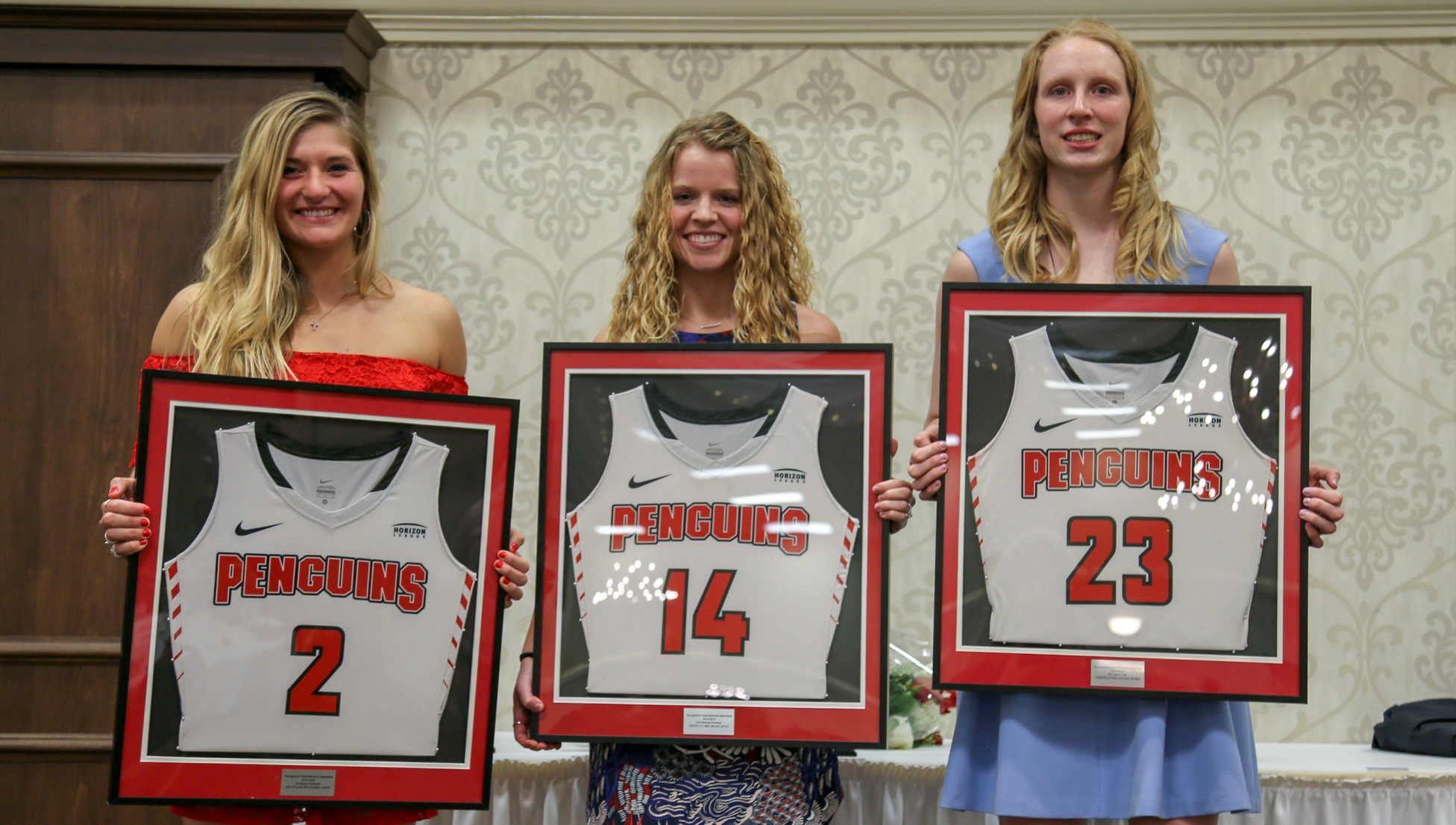 Seniors Alison Smolinski, Melinda Trimmer and Sarah Cash received framed jerseys at the 2018-19 Youngstown State Women's Women's Basketball Postseason Banquet.