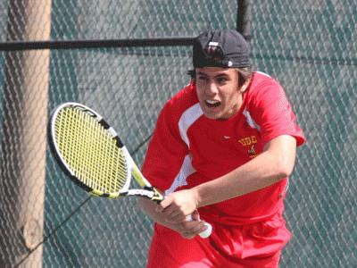 Miguel Uzcatequi uses his power to return a ball enroute to his singles match win