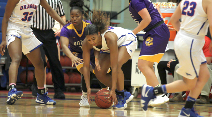 Sophomore Dejanae Roebuck gets one of her career-high six steals in the No. 10 Blue Dragons' 59-31 victory over Dodge City on Wednesday at the Sports Arena. (Bre Rogers/Blue Dragon Sports Information)