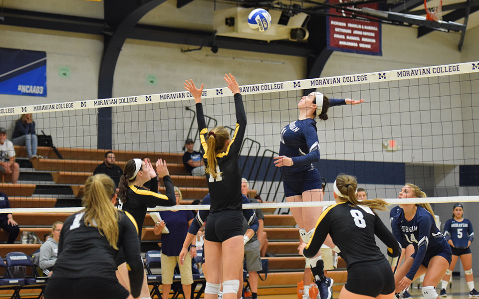 Senior Erin Tiger goes up for a kill in the 2018 season opener versus Baldwin-Wallace University.