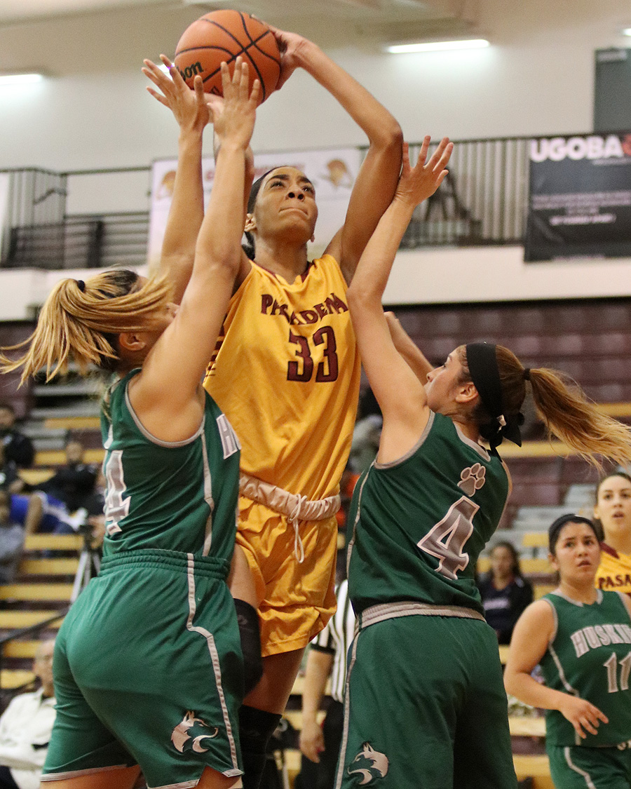 Lancer Kailyn Gideon goes up for a shot between defenders Wednesday night in a loss to East Los Angeles, photo by Richard Quinton.
