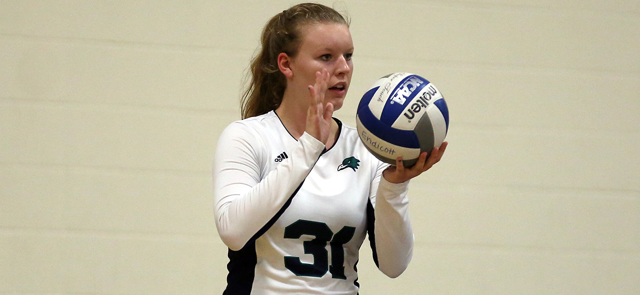 Zoey Gifford holds a volleyball.
