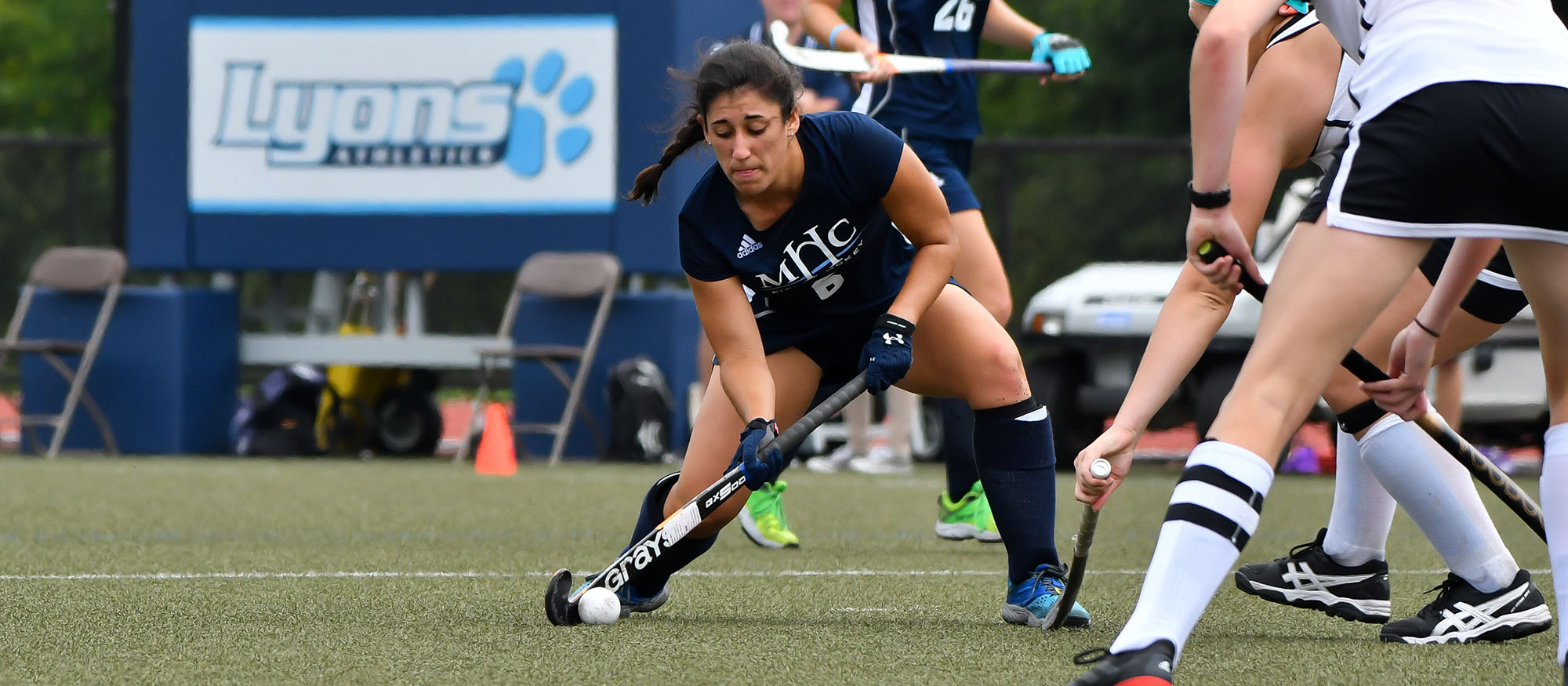 Action photo of Lyons field hockey player, Kaitlin Braz