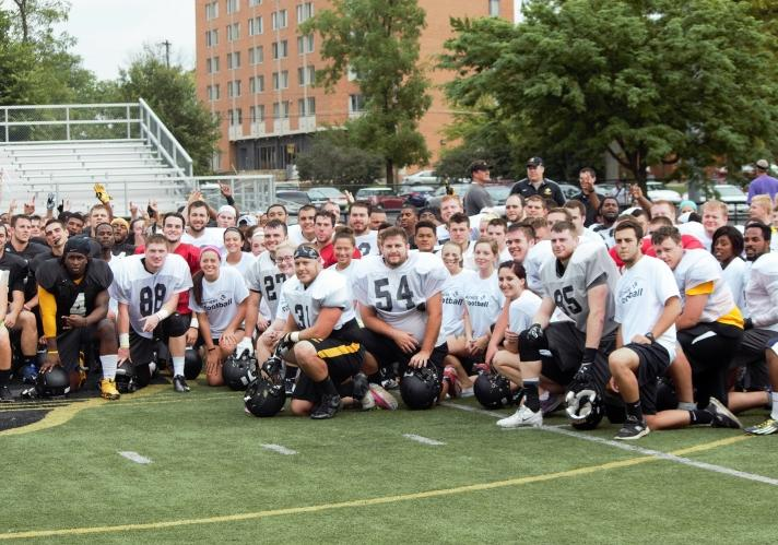 Students Display Skills At Annual Practice with Football Team