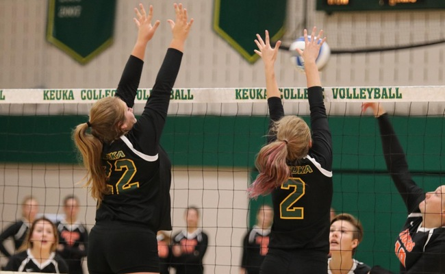 Katelyn Warren (22) and Alyssa Rex (2) attempting the block for Keuka -- Photo by Mary Mullen