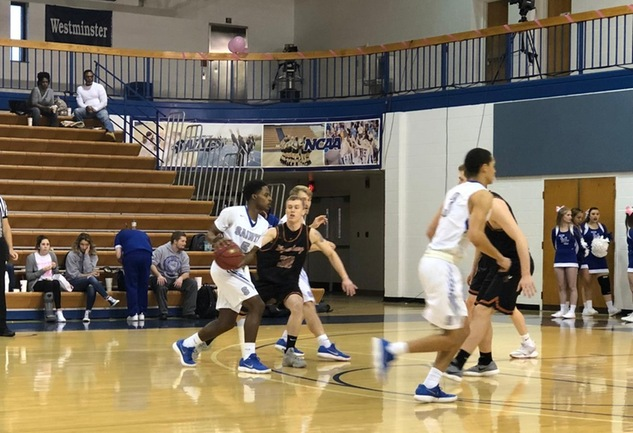 King Scores 1,000th Career Point at TMC in Saints Win Over Waynesburg