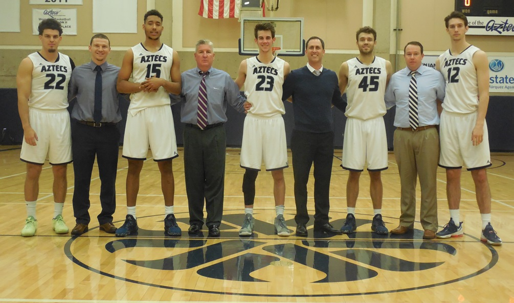 Pima men's basketball coaches and sophomores: (left to right): Dakota Kordsiemon, Dylan Hidalgo, Deion James, Brian Peabody, Jacob Anastasi, Mike Morgan, Emilio Acedo, Joe Hickle and Damon Dubots. The Aztecs will be the No. 2 seed at next week's Region I, Division II tournament. Photo by Raymond Suarez.
