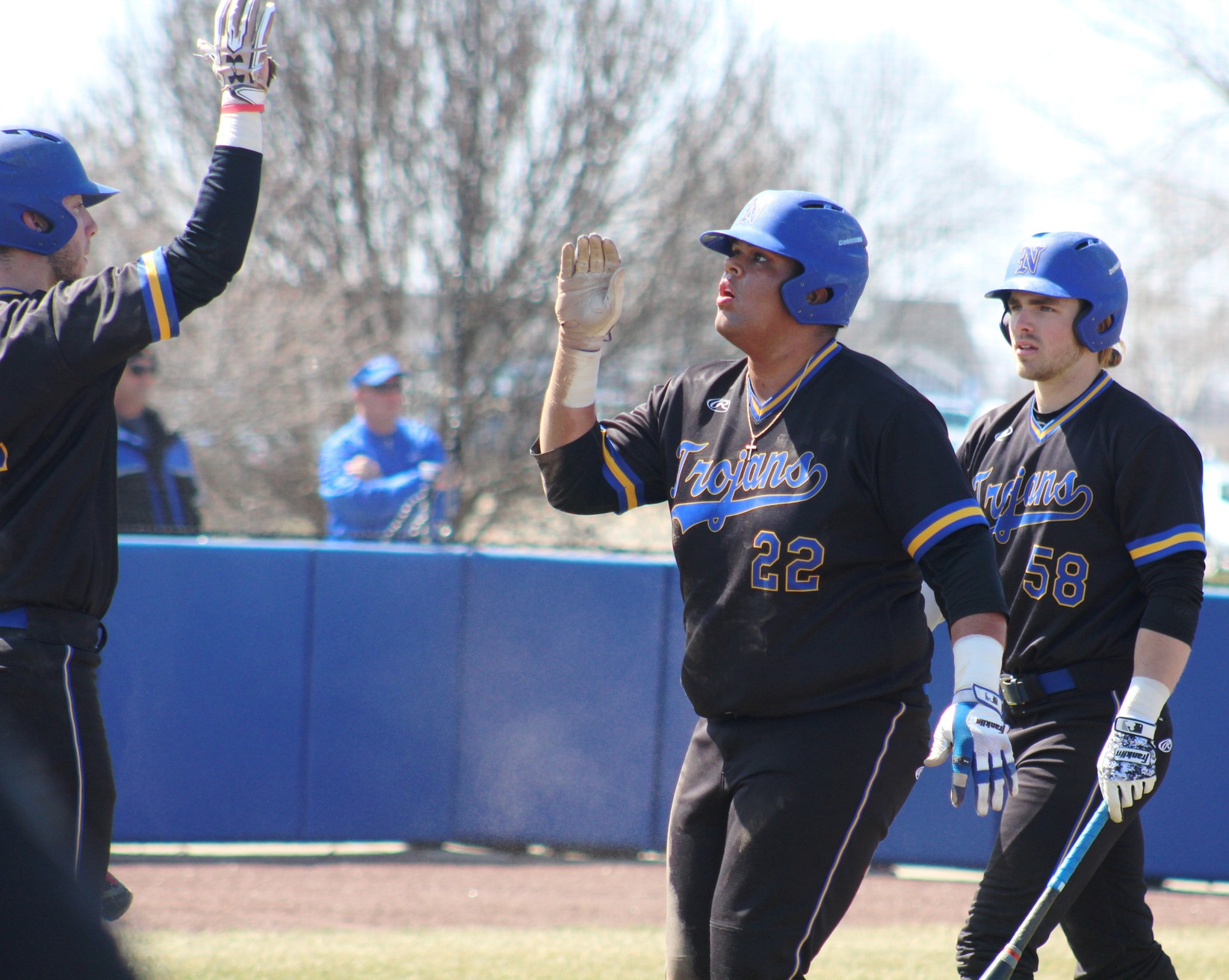 NIACC's Kamrin Arons (22) gets a high five after scoring a run in series against Kirkwood this season.