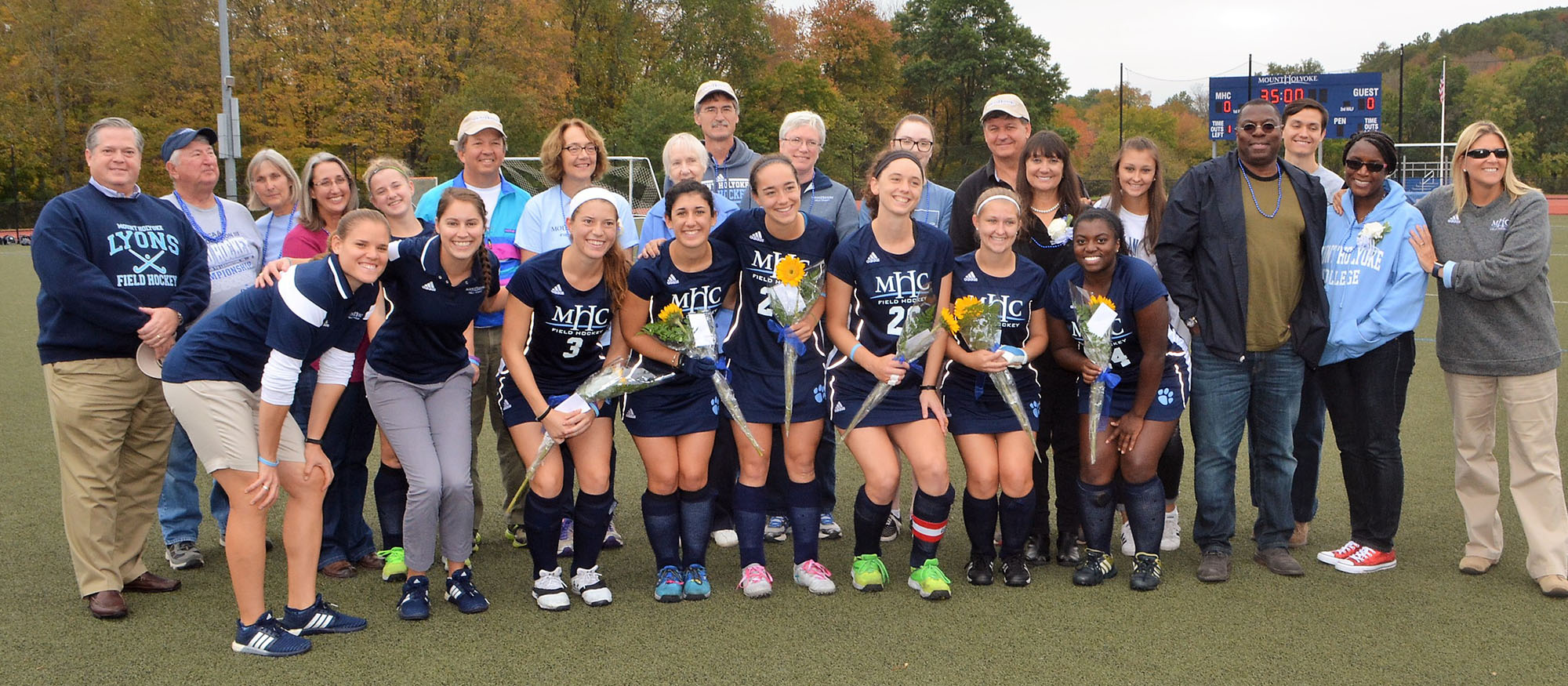 Photo of the Lyons field hockey team's six seniors and their families during a pre-game ceremony on October 14, 2017 against Wheaton.