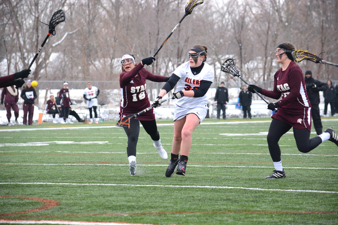Oilers Win 9-7 in Snowy Game at Armstrong