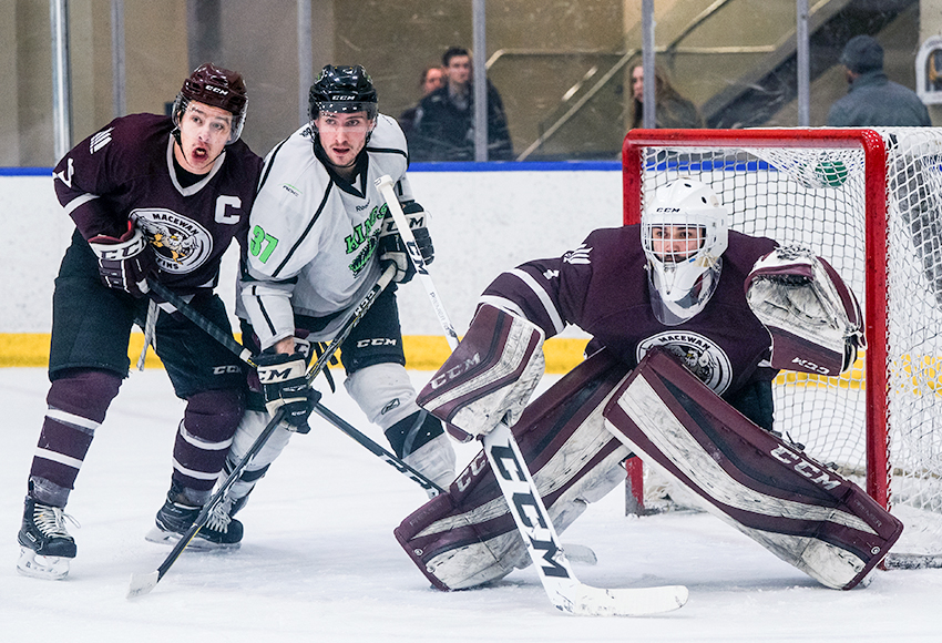 Griffins goaltender Marc-Olivier Daigle stares down a Red Deer College shooter with teammate Ryan Benn and Kings forward Tyrell Mappin in front of the net. Daigle was outstanding, making 33 saves to lead MacEwan to a 4-1 win (Matthew Jacula photo).
