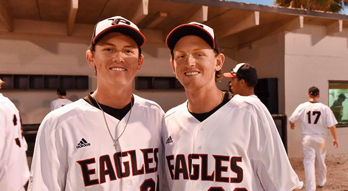 Justin Tworek and Chad Tworek smile after pitching the Eagles to a 3-0 shutout. (Photo by Tom Hagerty, Polk State.)