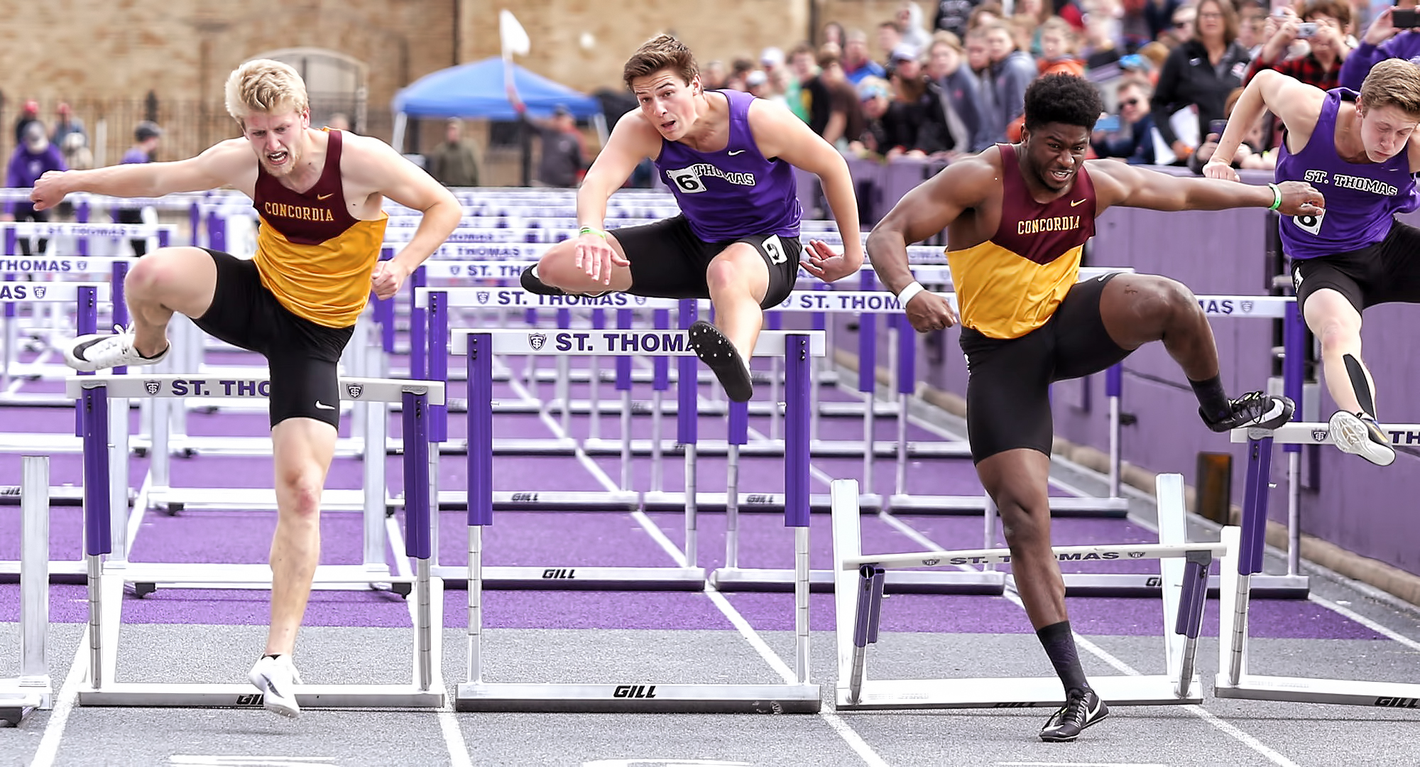 Willie Julkes (R) and Matt Bye both clear the last hurdle on their way to Top 5 finishes in the 110-meter hurdles at the MIAC Meet. (Photo courtesy of Nathan Lodermeier).