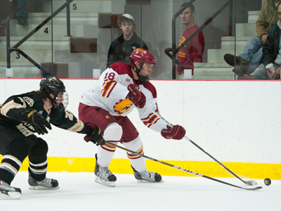 Andy Huff outraces a Western Michigan skater for the puck in Friday's 3-1 home win over the Broncos.  (Photo by Ed Hyde)