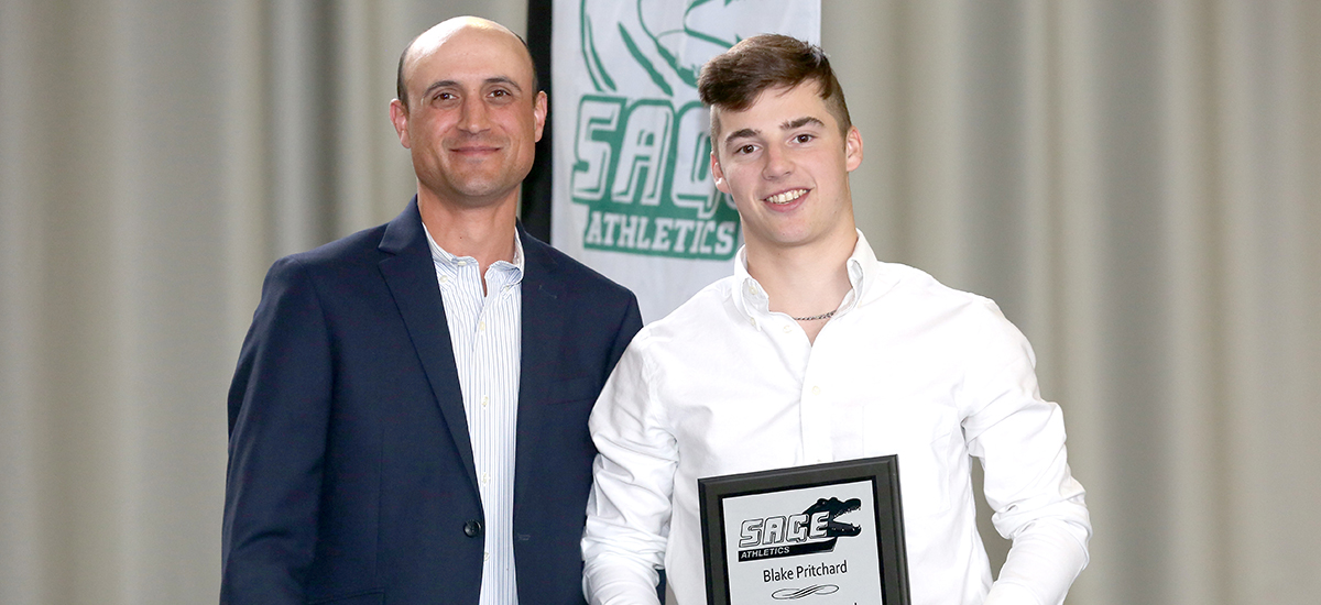 Head men's golf coach Kevin Cain presents Blake Pritchard with Gator of the Year status in golf