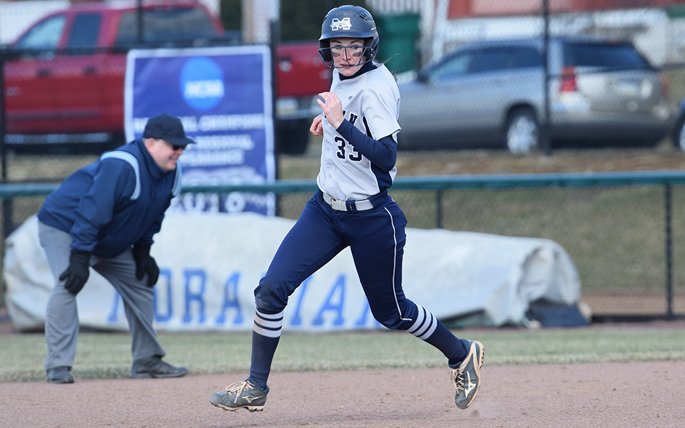 Senior Madison Shaneberger runs between first and second in a game versus Drew University at Blue & Grey Field.