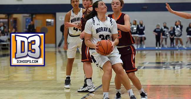 Camille McPherson '17 drives to the hoop versus Susquehanna University in January 2017.