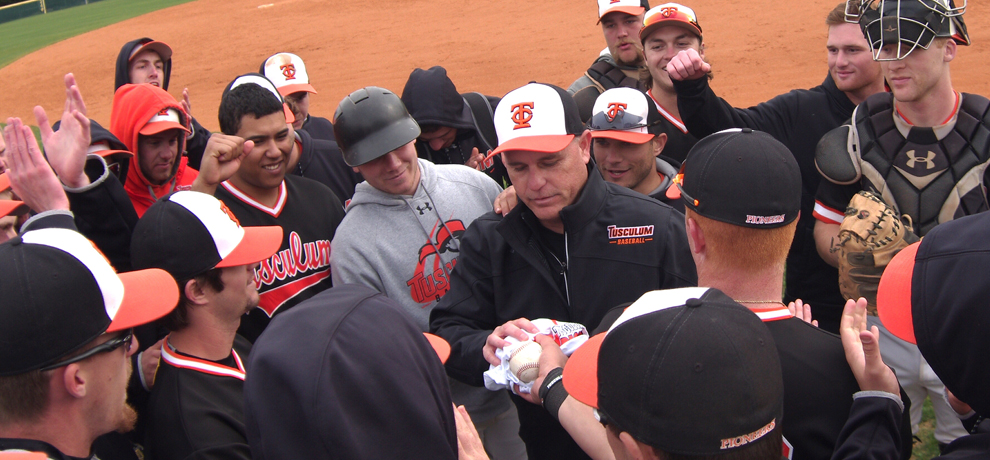 Coach Doug Jones is congratulated by his team following TC's 7-5 win over Lenoir-Rhyne, his 700th career win as head coach (photo by Chris Lenker)