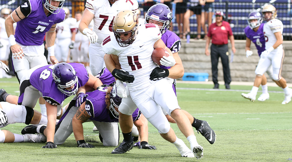 Harry Henschler wraps up one of his 10.5 tackles for loss. (Photo by Daryl Tessmann, d3photography.com)