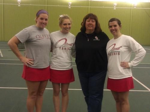 Mary Anne McMullen is surrounded by the three seniors on the 2012 team.
