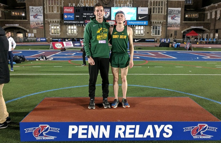Runners Kobie Lane and Nick Arnecke standing on the podium at Penn Relays.