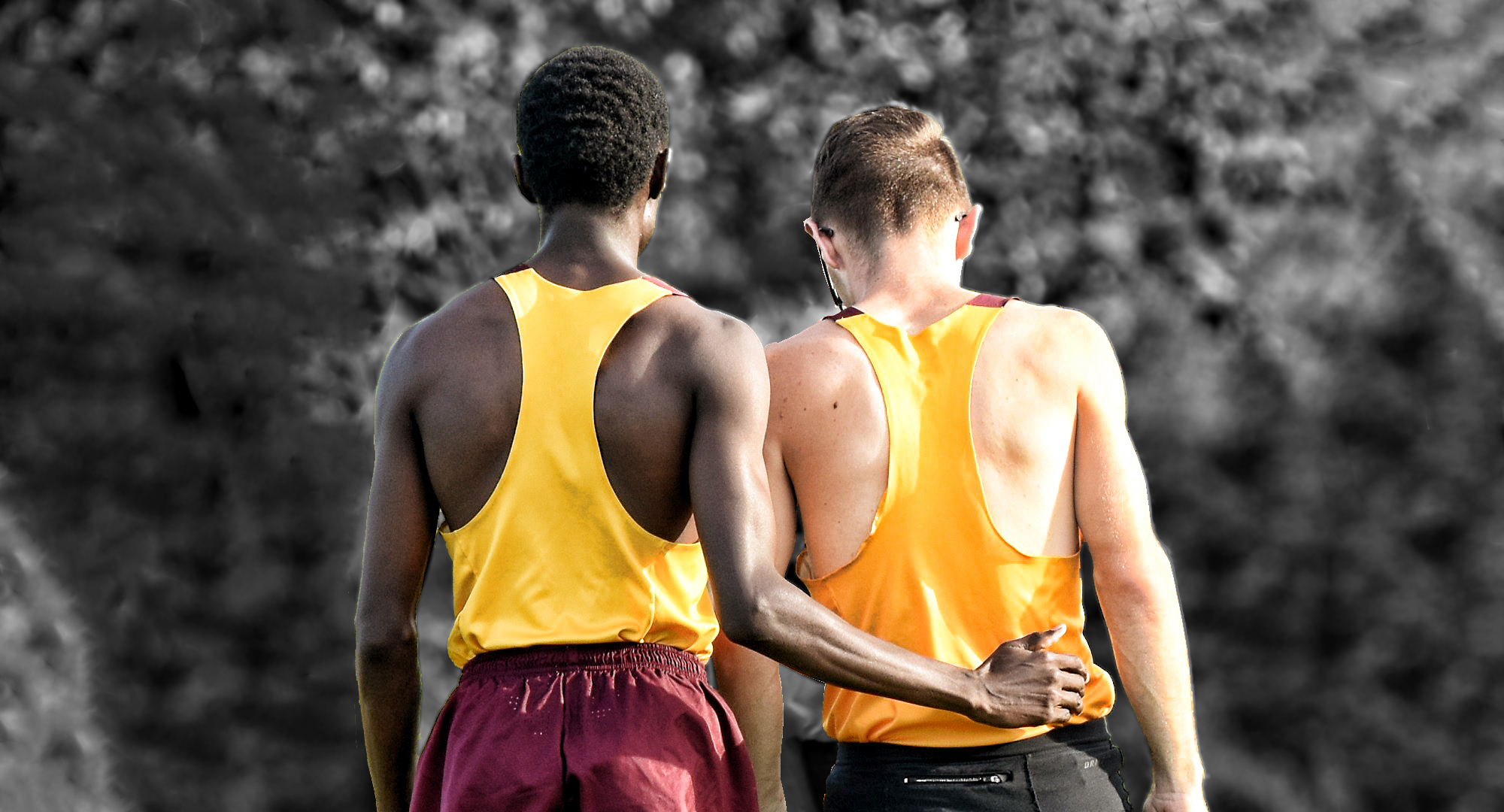 Munir Isahak (L) and Eric Wicklund talk over strategy before a race.