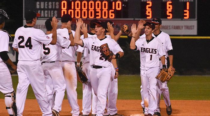 The scoreboard tells the story as the Eagles celebrate after beating Hillsborough 9-2. (Photo by Tom Hagerty, Polk State.)
