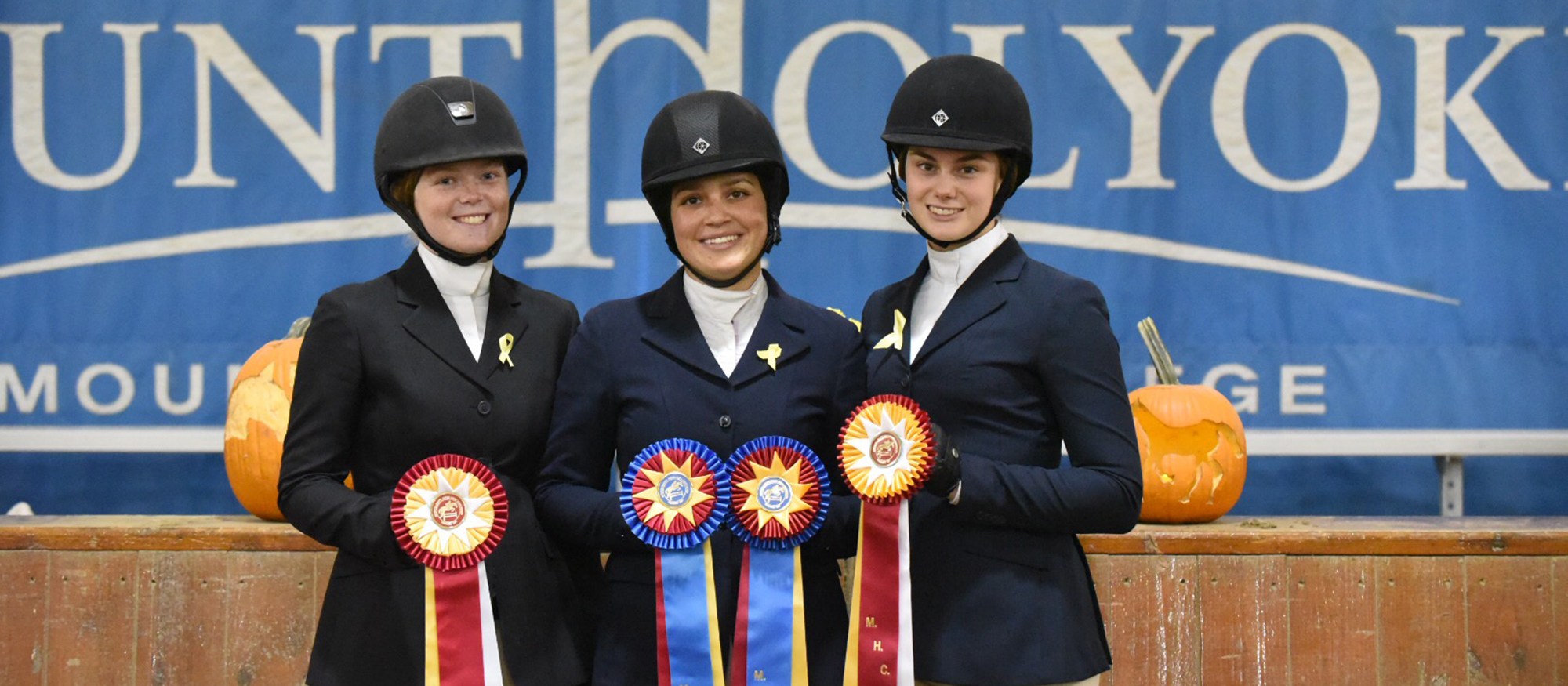 Photo of Lyons riding student-athletes Sara Hearn, Indra Rapinchuk-Souccar and Sierra Dunn following the October 27th, 2018 Home Show.